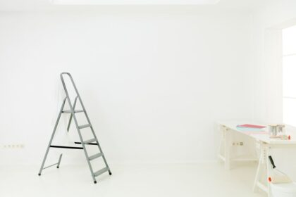 Home renovation in room with paint tools